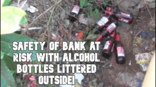 Safety Of Bank At Risk With Alcohol Bottles Littered Outside!