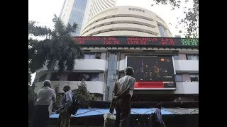 Sensex, Nifty flat; Voda Idea drops 8%