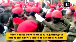 Women police trainees dance during passing out parade ceremony celebrations in Bihar's Sitamarhi