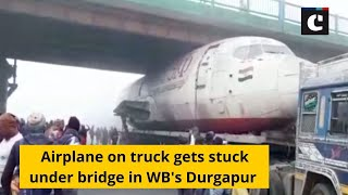 Airplane on truck gets stuck under bridge in WB's Durgapur