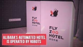 At Alibaba's FlyZoo futuristic hotel, robots run the show