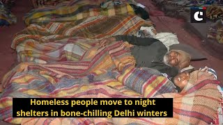 Homeless people move to night shelters in bone-chilling Delhi winters