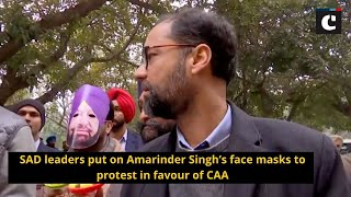 SAD leaders put on Amarinder Singh's face masks to protest in favour of CAA
