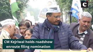 CM Kejriwal holds roadshow enroute filing nomination