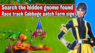 Search the hidden gnome found in between a race track, a cabbage patch, and a farm sign Location