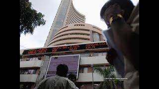 Sensex slips 100 points, Nifty below 12,100; Suzlon jumps 10%