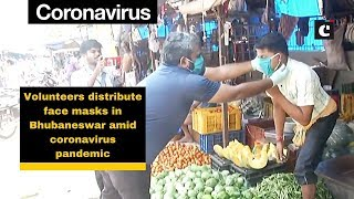 Volunteers distribute face masks in Bhubaneswar amid coronavirus pandemic