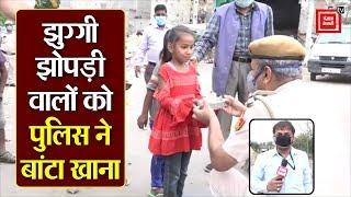घर से निकले लोगों को दिल्ली पुलिस बांट रही मास्क, लोहा पुल से देखें खास रिपोर्ट