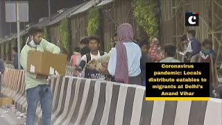 Coronavirus pandemic: Locals distribute eatables to migrants at Delhi's Anand Vihar