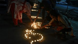 Millions respond to PM Modi's appeal; people light candles, diyas to mark fight against COVID-19