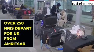 Over 250 NRIs Depart For UK from Amritsar Airport Amid Lockdown | Catch News