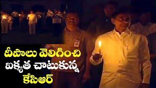 Telangana CM Kcr lighting candle at DIYA by Modi