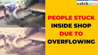 Locals Rescue People Stuck Inside Shop Due To Overflowing Nullah   Catch News