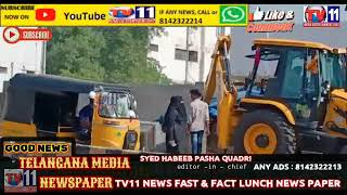 GHMC OFFICIALS DEMOLISH ILLEGAL OCCUPY OF FOOTPATH FOR SHOPS  AT TOLICHOWKI HAKIMPET HYDERABAD