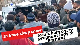 Pulwama: In knee deep snow, locals help carry pregnant lady to hospital