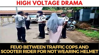 HighVoltageDrama | Heated arguments between traffic cops and scooter rider for not wearing helmet