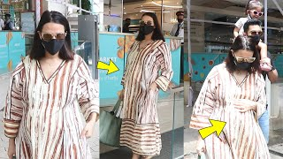 Second time Pregnant Neha Dhupia baby bump clearly visible snapped with hubby Angad bedi