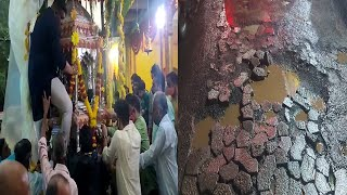 Palki in Mapusa through potholes! Angry residents ask if roads can be hotmixed for Shah why not God?