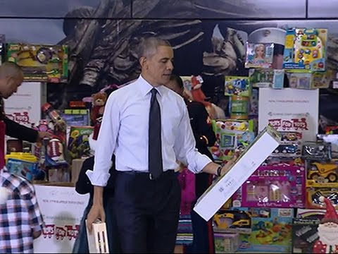 Obama Helps Deliver Toys to Marine Corps Drive News Video
