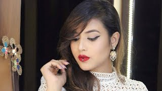 HOW TO DO WINGED EYELINER AND CLASSIC RED LIP WITH A TWIST