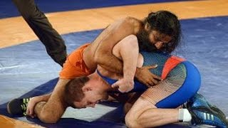 Baba Ramdev beats Olympic medalist in promotional wrestling bout