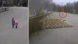 Unbelievable Moment a Mother And Child Avoid Being Crushed by a Falling Building by Inches