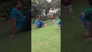 Indian Cricketer Yusuf Pathan does a cartwheel as his son Aayan tries to imitate him
