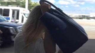 Amber Heard Annoyed With Invasive Paparazzi Covers Her Face With Handbag