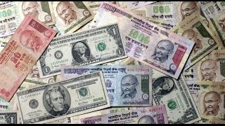Rupee gains two paise against dollar