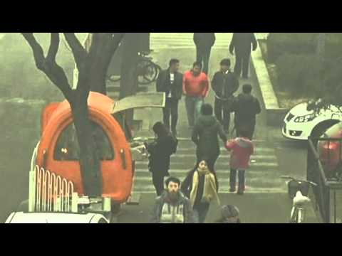 Raw- Heavy Smog Blankets City Streets of Beijing News Video
