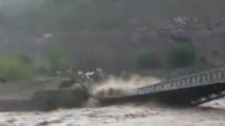 Raw- Flooding Causes Bridge Collapse in Pakistan - News Video