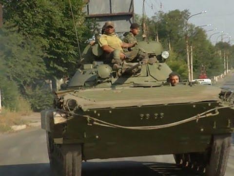 Weapons Convoys Seen Rolling in Eastern Ukraine News Video