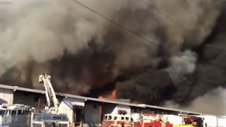 Raw- NJ Warehouse Fire Burning Out of Control News Video