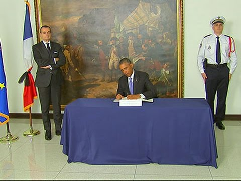Raw- Obama Pays Respects at French Embassy News Video
