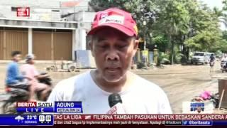 Warga Villa Nusa Indah Bogor Bersihkan Lumpur