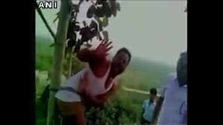 Watch- Locals in Bihar's Chhapra thrash a man for allegedly carrying liquor bottles
