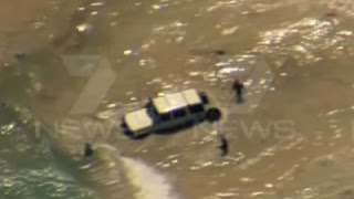 Raw: Police Chase Ends with Plunge into Ocean